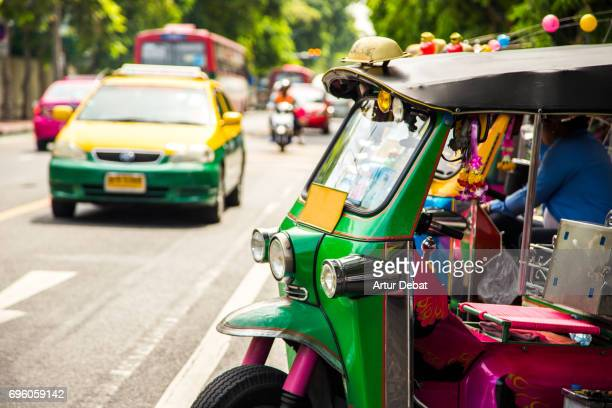 Beautiful colorful Tuk Tuk Rickshaw in the streets on Bangkok during day.