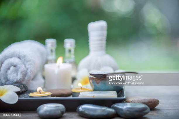 beautiful composition of spa treatment on wooden table - spa stock pictures, royalty-free photos & images