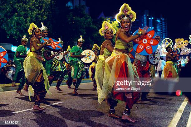CONTENT] Beautiful costumed dancers performing in a street festival to celebrate Deepavali in Little India
