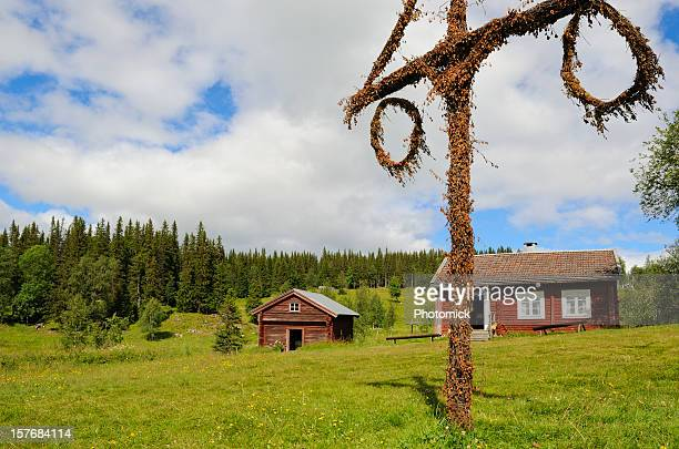 Beautiful cottage and barn with maypole in northern Sweden