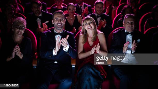 beautiful couple applauding while watching opera - performance stock pictures, royalty-free photos & images