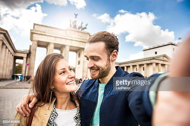 Beautiful couple celebrating in Berlin - Brandenburg Gate