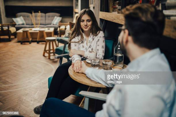 Beautiful couple drinking coffee and enjoying themselves in the coffee shop