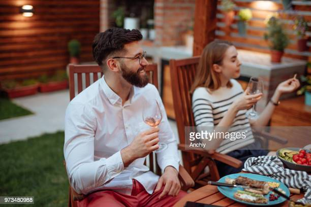 Beautiful couple drinking wine in a summer garden