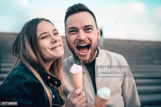 Beautiful Couple Eating Ice Cream in Autumn