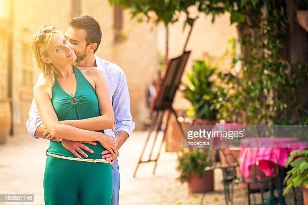 Beautiful Couple Embracing in Typical Italian Town