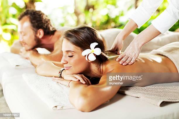 Beautiful couple enjoying in a back massage.