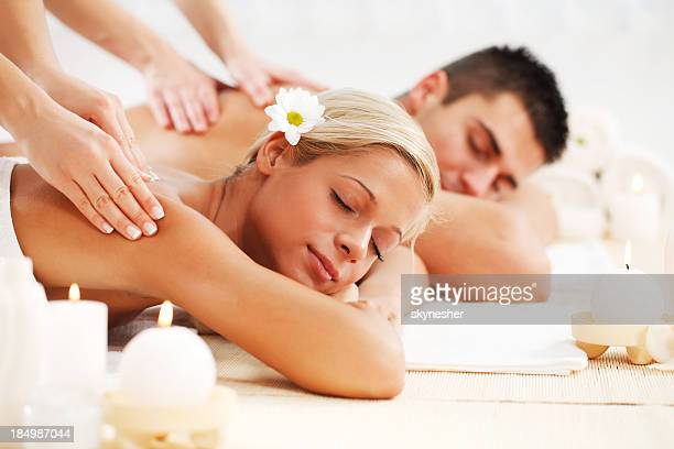 beautiful couple enjoying in the back massage. - body massage stock photos and pictures