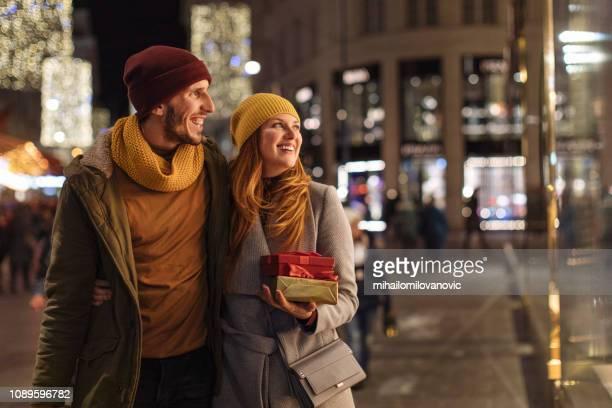 Beautiful couple happy on the street during Christmas time