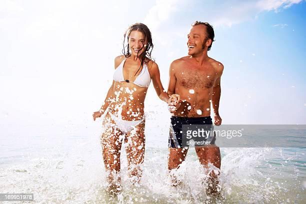Beautiful couple having fun at the beach.