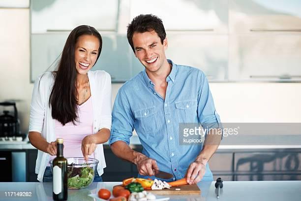 Beautiful couple having fun in the kitchen