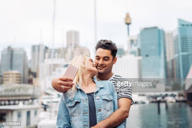 beautiful couple making selfie for social media - darling harbour stock pictures, royalty-free photos & images