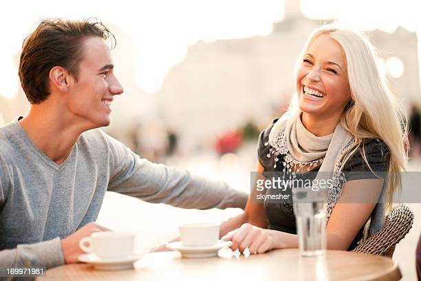 Beautiful couple sitting in a cafe