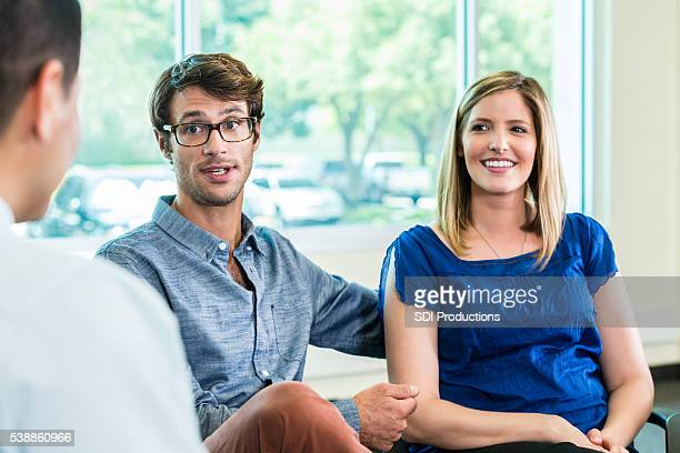 Beautiful couple speak to a professional