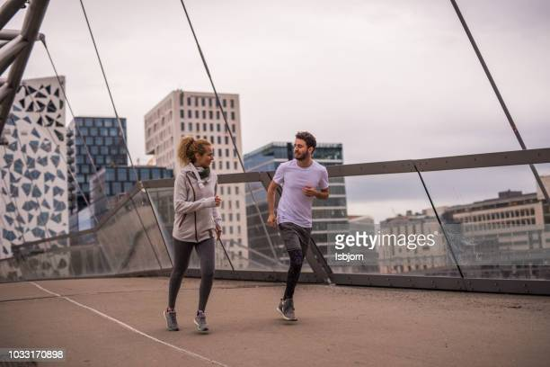 beautiful couple training together at sunset in down town. - oslo stock pictures, royalty-free photos & images