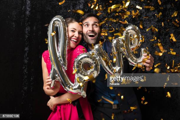 beautiful couple with love balloon and glitter