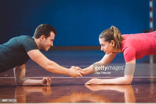 Beautiful couple working out in gym