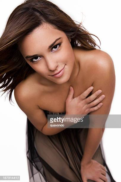 beautiful cover girl young woman in gown, hand over heart - strapless evening gown stock photos and pictures