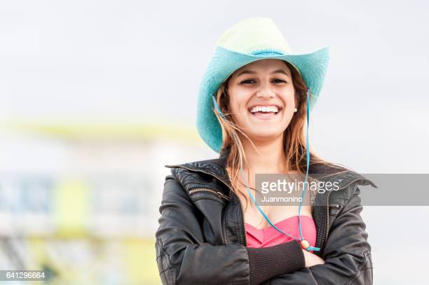 Beautiful cowgirl at the beach