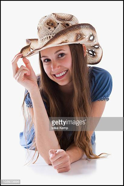 Beautiful cowgirl tipping her hat