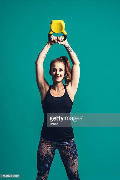 Beautiful Cross Training woman with kettlebell