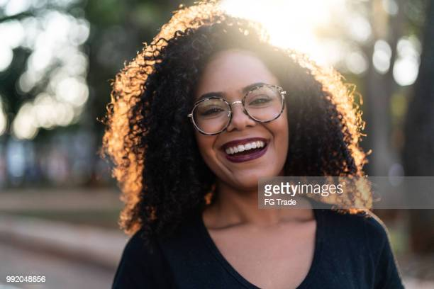 beautiful curly hair woman - black people laughing stock photos and pictures