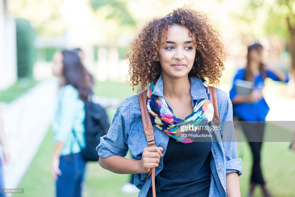 Beautiful curly haired African American college or high school student : Stock Photo