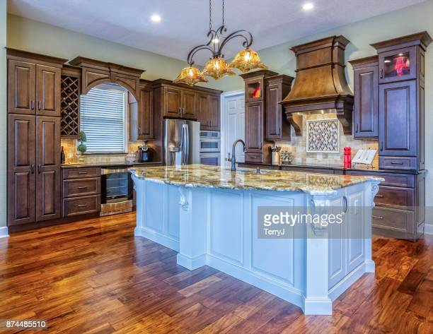 beautiful custom kitchen with island in an estate home - southern usa stock pictures, royalty-free photos & images