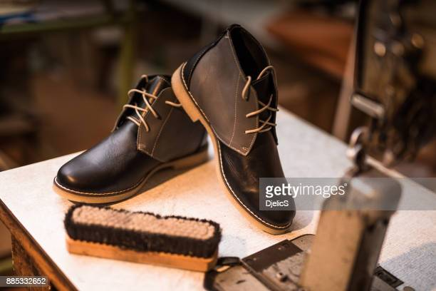 beautiful custom made leather shoes next to sewing machine. - calzature di pelle foto e immagini stock