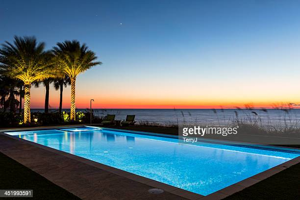 beautiful custom pool with sunset on the beach - florida landscaping stock pictures, royalty-free photos & images