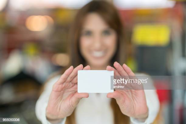 Beautiful customer holding a card to edit