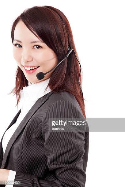 美しい笑顔の女性顧客サービスとヘッドフォンを白背景