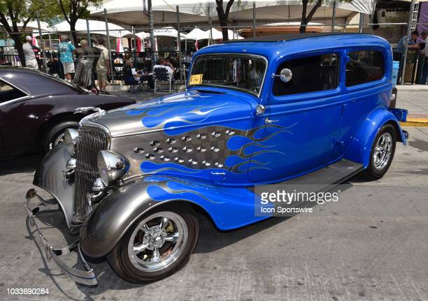 Beautiful customized silver and blue paint scheme on the 1934 Ford 2 door sedan at the Hot August Nights Custom Car Show the largest nostalgic car...