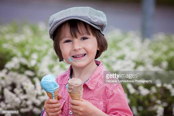 Beautiful cute Caucasian boy, eating ice cream