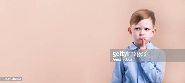 a beautiful cute thoughtful boy -  emotion studio shot - children only stock pictures, royalty-free photos & images