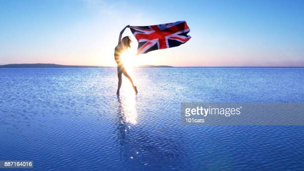 beautiful dancer holding united kingdom's flag on the lake. - national landmark stock pictures, royalty-free photos & images