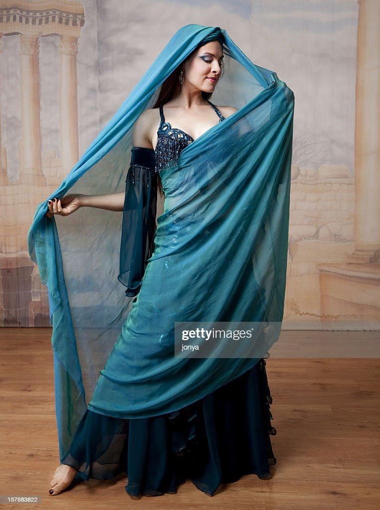 beautiful dancer in costume wearing a veil : Stock Photo