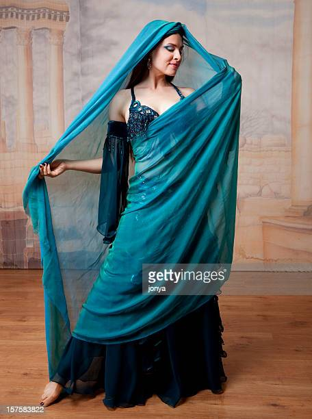 beautiful dancer in costume wearing a veil