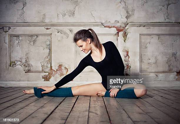 beautiful dancer stretching - leotard stock photos and pictures