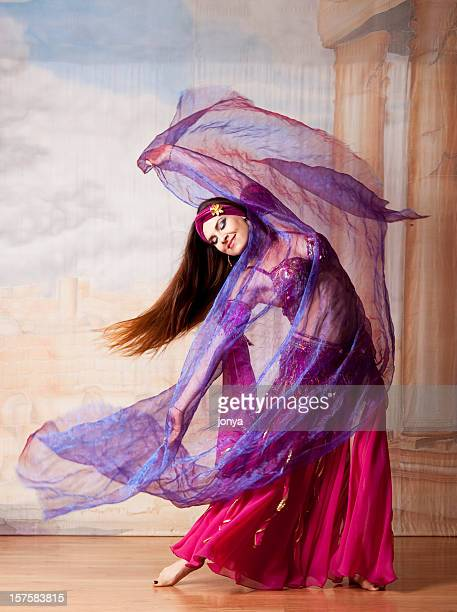 beautiful dancer with veil - belly dancing stock photos and pictures