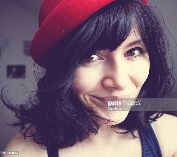 Beautiful dark haired girl with red hat