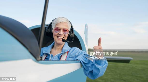 beautiful day for flying - working seniors stock pictures, royalty-free photos & images