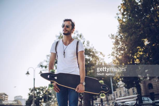 beautiful day for skateboarding - longboard skating stock pictures, royalty-free photos & images