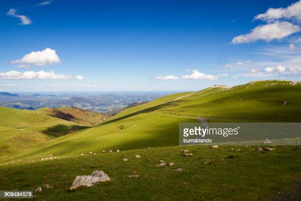 a beautiful day for this amazing view across the pyrenees mountain ranges - cammino di santiago di compostella foto e immagini stock