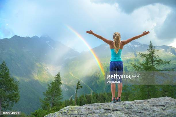 beautiful day in the mountains - rainbow sky stock pictures, royalty-free photos & images