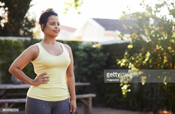 beautiful days like these just motivate her to workout - curvy women stock pictures, royalty-free photos & images