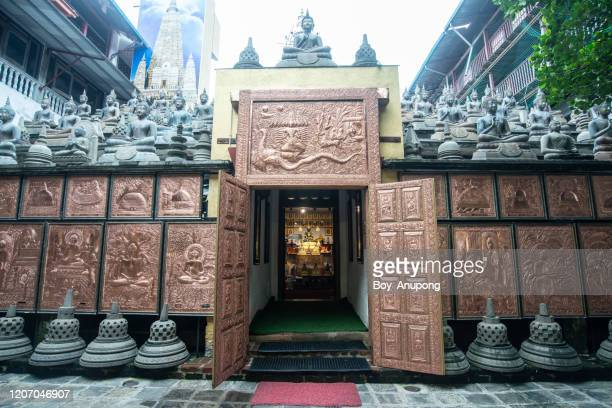 beautiful decoration inside gangaramaya temple of colombo the capital city of sri lanka. - colombo stock pictures, royalty-free photos & images