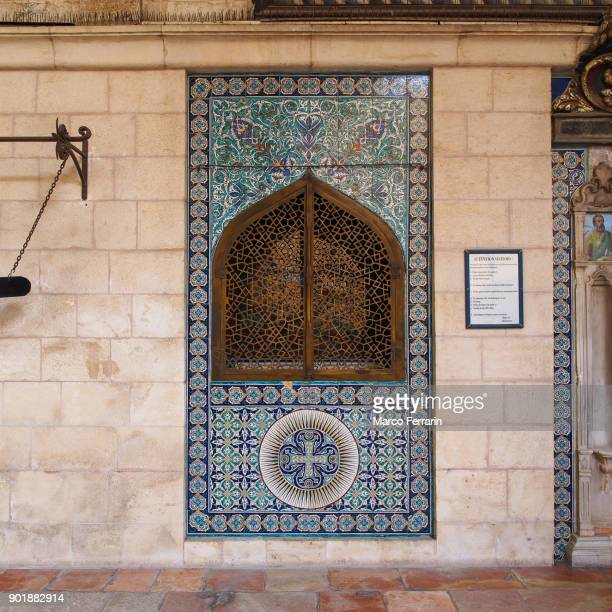 beautiful decorative tiles, the outer wall near the main entrance to the cathedral of saint james, armenian quarter in the old city of jerusalem - jerusalem old city stock pictures, royalty-free photos & images