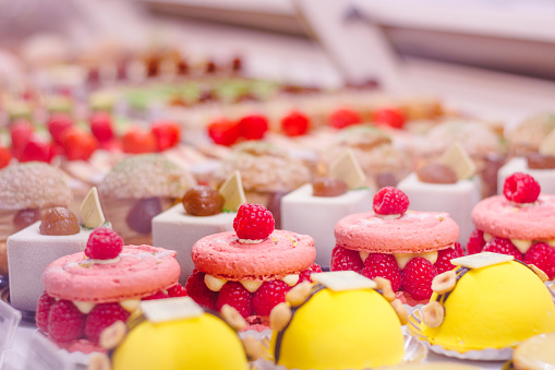 Beautiful delicious pastries with raspberry on a showcase in a French shop. 1076158482