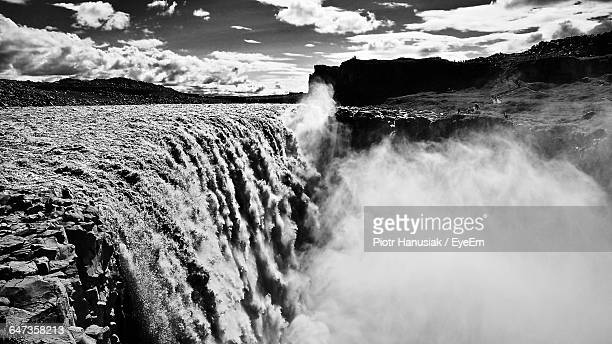 beautiful dettifoss waterfall against sky - dettifoss waterfall stock photos and pictures